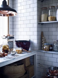 Fired Earth kitchen - victorian style white tiles, storage jars and baskets