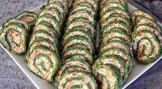 Lækker opskrift på lakseroulade med spinat og flødeost, som er nem og lige til at gå til med ingrediensliste og fremgangsmåde.