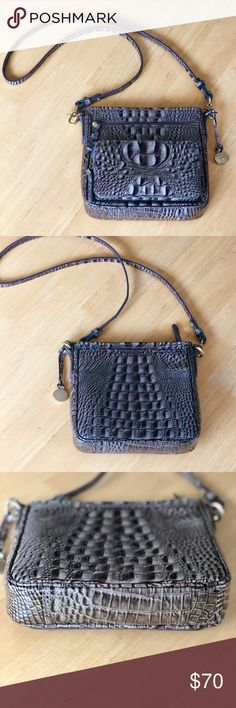Brahmin Tilda Crossybody Taupe Gray Gorgeous Brahmin Tilda Taupe gray Melbourne Croco Embossed Crossbody Handbag that is in excellent condition. The bag closes with a zipper. The inside has an open pouch with 2 pen holders on on the outside. On the other side is another open pouch. The back has an open pouch and the front has two zipper pockets. The smaller pocket opens to reveal an organizer. 6 credit card slots and one open pocket. GUC. Small peeling noted on zipper tab in photos…