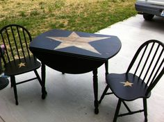 Primitive black drop-leaf table and chairs refinished by Tammy's Primitives. looks like the one set i done but my table star was not quite as big