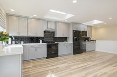 A lot of people like to add kitchen islands but sometimes they just aren't useful for the way you cook or entertain.  Don't feel married to it just because thats how it is now - these homeowners removed theirs and now the kitchen loves MASSIVE compared to how it was laid out originally. #kitchenremodel #kitchendesign #kitchenideas #kitchenlayout