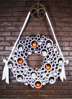 When you think of PVC pipe, you probably don't immediately think of fun, creative projects. PVC pipe is a great medium to employ while making holiday decorations or spending the aft… Wreath Crafts, Diy Wreath, Diy Crafts, Wreath Ideas, Tulle Wreath, White Wreath, Burlap Wreaths, Ornament Wreath, Holiday Wreaths