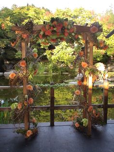 Wedding Arbor decorated in vine with roses, millet and hydrangeas - Simply Regal by Julie