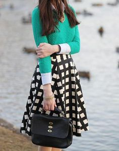 ~A swingy ladylike skirt, along with a thin cable-knit sweater and a solid button-down, creates an elegant and easy spring look. Finish things off with a top-handle bag and pretty much any type of shoe, from  a ballet flat to a pointed pump. 50 Spring Outfits to Copy Right Now | StyleCaster
