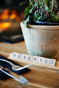 Scrabble tiles~ Place settings, food labels, reserved seating. . .