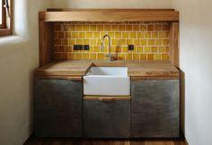 Utility sink unit in traditional home in Petersham featuring zinc doors, Belfast sink and character oak worktop.