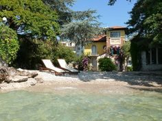 Enchanting + holiday villa + at + lake + with + private + private beach + and + enclosed + garden ., Enchanting + holiday villa + at + lake + with + private + private beach + and + enclosed + garden holiday home in Gardone Riviera from HomeAway! Cheap Pool, Beach Hacks, Cottages By The Sea, Luxury Villa Rentals, Beautiful Villas, Lake Garda, Italy Vacation, Places To Go, Pergola