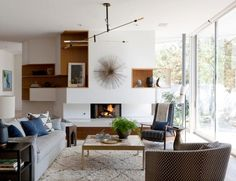 Love this airy feel, mid century elements but with a very open feel, soft textures like the rug and linen make it cozy