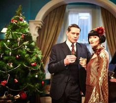 Jack Robinson (Nathan Page) and Phryne Fisher (Essie Davis) in the Christmas Episode of Miss Fisher's Murder Mysteries, season 2