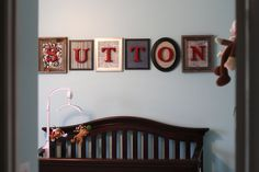 Use this idea, spell out family, use pictures as the background. I like different size frames not sure on different colors though