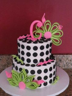 Fan-like, moss green flowers, black polka dots, hot pink accents and leaves
