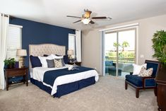 Tipping the scale in the darker side for the nautical color scheme, we have the master bedroom of our 3,285 sq. ft. plan at our Catalina community.