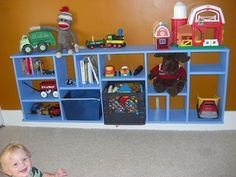 Turn a book shelf on it's side for storage cubbies....genius!