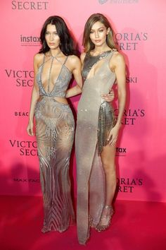 Bella Hadid and Gigi Hadid pose during a photocall after taking part in the 2016 Victoria's Secret Fashion Show.