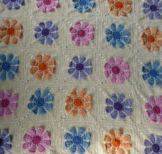 Daisy Square Baby Blanket - Pretty sure I can fake this pattern with my knifty knitter and flower loom.
