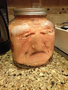 Put a costume mask in a jar then add water! You can also put a glow stick or submersible LED light in the jar for effect.