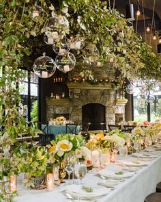 Greenery & Candles Above Long Table | Photo: Donna Von Bruening.