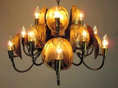 Brutalist 1970s torch cut brass chandelier by Tom Greene for The Feldman Co. Features 12 up-lights... pinned with Pinvolve