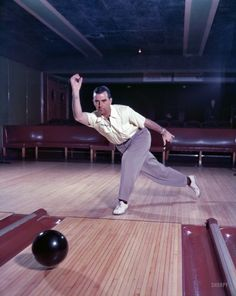 "Pro Bowl: 1951 - Professional bowler Buddy Bomar demonstrating technique. Photo by Bob Lerner for the Look magazine article ""Improve Your Bowling."""