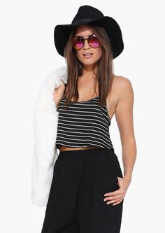 Pair with high waisted leggings and combat boots or put an oversized cardigan over it. Spaghetti strap top and pull on style.