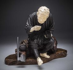 LARGE JAPANESE BRONZE AND IVORY OKIMONO, MEIJI PERIOD (1868-1912) A sculptural ornament of a man sitting on a log drinking tea; signed.