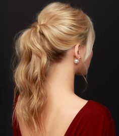 The chicest look for party may be a simple pony tail for you. Learn how to make it a perfect updo for the night! 1. Start by curling all of your hair away from your face into ringlets. 2. Use your fingers to comb out and loosen the curls. 3. Backcomb under the crown of your hair for fullness. 4. Using a comb, start from behind the ears and section off your hair. 5. Pull the back section up into a ponytail. 6. Twist the right side back over the hair-tie and fasten with bobby pins. 7. Re...
