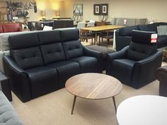 Chill sofa and chair by Jaymar. Black leather sofa with adjustable headrest and  full footrest. Made in Canada. At Ellis Brothers Furniture store.