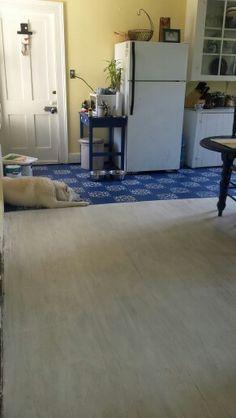 White washed hardwood and painted plywood flooring