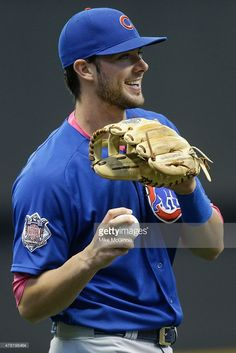 Kris Bryant of the Chicago Cubs throws in the outfield before the game against the Milwaukee Brewers at Miller Park on May 10 2015 in Milwaukee Wisconsin Espn Baseball, Chicago Cubs Baseball, Baseball Boys, Baseball Players, Bryant Baseball, Cubs Players, Cub Sport, Cubs Hat, Bear Cubs