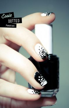 Essie (polish): white with black sprinkles with reverse design on ring finger (love the pic don't click the link though it's spam i think)