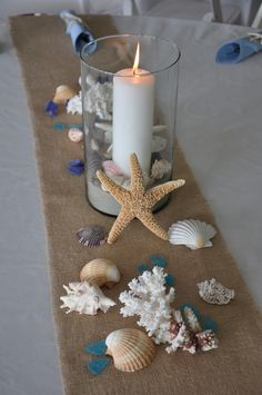 Great for a beach wedding or any other beach event.  Burlap runners/sea glass/shells/candles.  Pretty on white linen.
