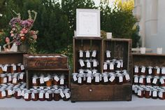 Homemade jam favors displayed in antique crates..