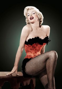Marilyn Monroe in corset and fishnet stockings.