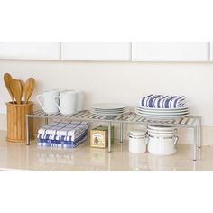 Keep kitchen clutter to a minimum with this expandable kitchen counter shelf. This white-iron shelf features a roomy space to keep provisions, spices, herbs, and condiments handy. The elegant platinum finish makes this shelf attractive and helpful. Kitchen Cabinet Shelves, Small Kitchen Cabinets, Kitchen Cabinet Remodel, Kitchen Cabinet Organization, Cabinet Space, Storage Cabinets, Kitchen Storage, Organizing Kitchen Counters, Dish Cabinet