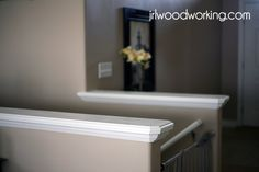Tutorial on how to add a crown molding cap to any half wall or wall around stairs. Inexpensive, easy, and makes it look so much better!