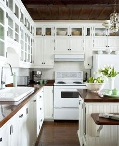 Butcher block kitchen counter tops and simple white tile backsplash. by alyce