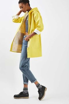 Stay cute whatever the weather throws at you with this hooded rain mac in yellow. Cut in a longer length, it features a contrast umbrella printed lining and silver trim detail. #Topshop