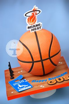 Miami Heat Basketball Cake - Basketball cake for Gus, who loves Miami Heat. The logo is an edible image. The bottom of the basketball is an hollow styro hemisphere, the top half is cake. Basketball Cookies, Basketball Birthday, Basketball Party, Street Basketball, Basketball Hoop, Basketball Jersey, Miami Heat Basketball, Basketball Videos, Basketball Stuff