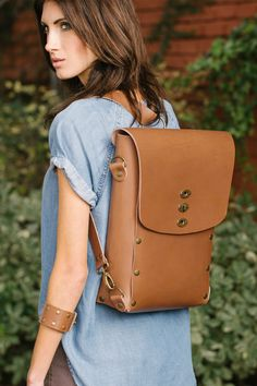 Held together without a stitch, the new Umuragi Convertible Backpack's generous interior makes it one outstanding bag for travel, school, or business.