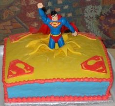 "super easy cake - just frost and use yellow candy for the ""breakthrough"" - we have plenty of superman toys too!"