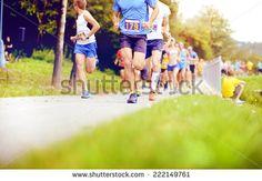 Group of unidentified marathon racers running, detail on legs - stock photo