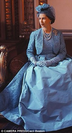 HM Queen Elizabeth II in an Aquamarine Blue gown and bolero designed by Norman Hartnell for Princess Margaret's wedding in 1965.
