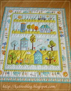 Baby quilt, site has close up photos of different parts of the quilt