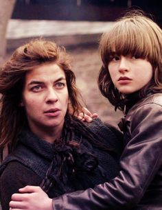Osha is the Wildling who tried to rob Bran Stark, was captured by Robb & Theon, and put to work in the kitchens of Winterfell. After Theon returned and burned the place and tried to capture Bran & Rickon, Osha and Hodor fled with them north to The Wall.