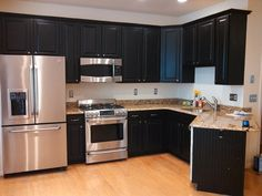 After  Kitchen Cabinets: Oak to Black - Houzz  (just painted the cabinets and updated handles & pulls)