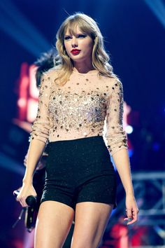 Taylor Swift Photos Photos - Singer Taylor Swift performs onstage during the 2012 iHeartRadio Music Festival at the MGM Grand Garden Arena on September 22, 2012 in Las Vegas, Nevada. - 2012 iHeartRadio Music Festival - Day 2 - Show