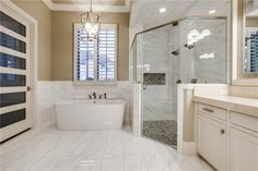 Classic standalone tub and river-rock floored shower