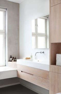 Beautiful neutral colour palette in this Scandinavian design bathroom. Really pretty pale timber with the white bathroom benchtop.