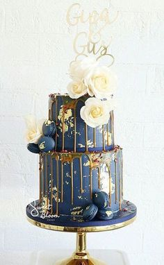 blue and gold drip wedding cake #weddings #cakes #weddingcakes #weddingideas #weddinginspiration #himisspuff