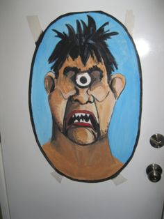 Greek Mythology party - Pin the Eye on the Cyclops. Hand-painted cyclops and eyes with magnets on back (hung on metal door).